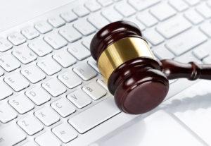 Gavel at the computer keyboard